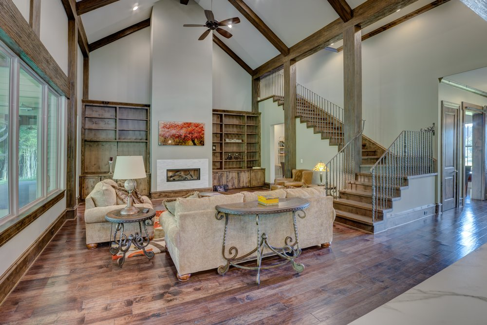 vaulted-coffered-ceiling-fan-stairs-wood-floors-architecture-floor-271632.jpg