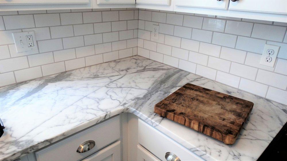 marble-detail-subway-tile-backsplash-butcher-block-kitchen-countertop-remodel.jpg