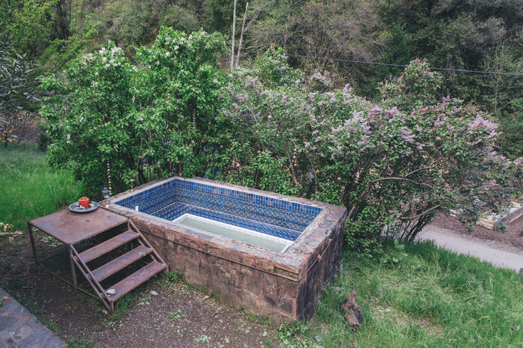 Soak away the day in the 20 person wood-fired hot tub, right above Dani Falls. -
