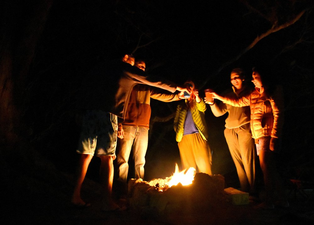 Camp each night under the stars, sharing stories around the fire from the day. -