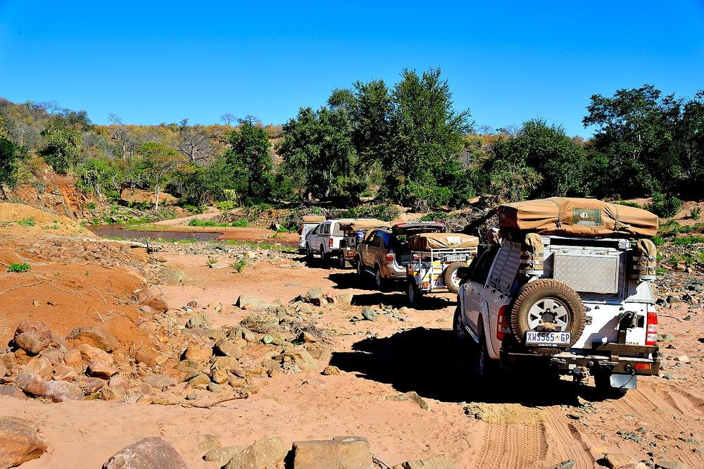 - Four vehicles traveling 1000 kilometers through the bush.