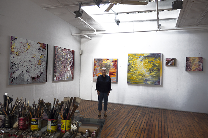 Judith Murray, NA in her New York studio, July 2018, pictured with paintings to be included in  Judith Murray: Tempest  at Sundaram Tagore Chelsea