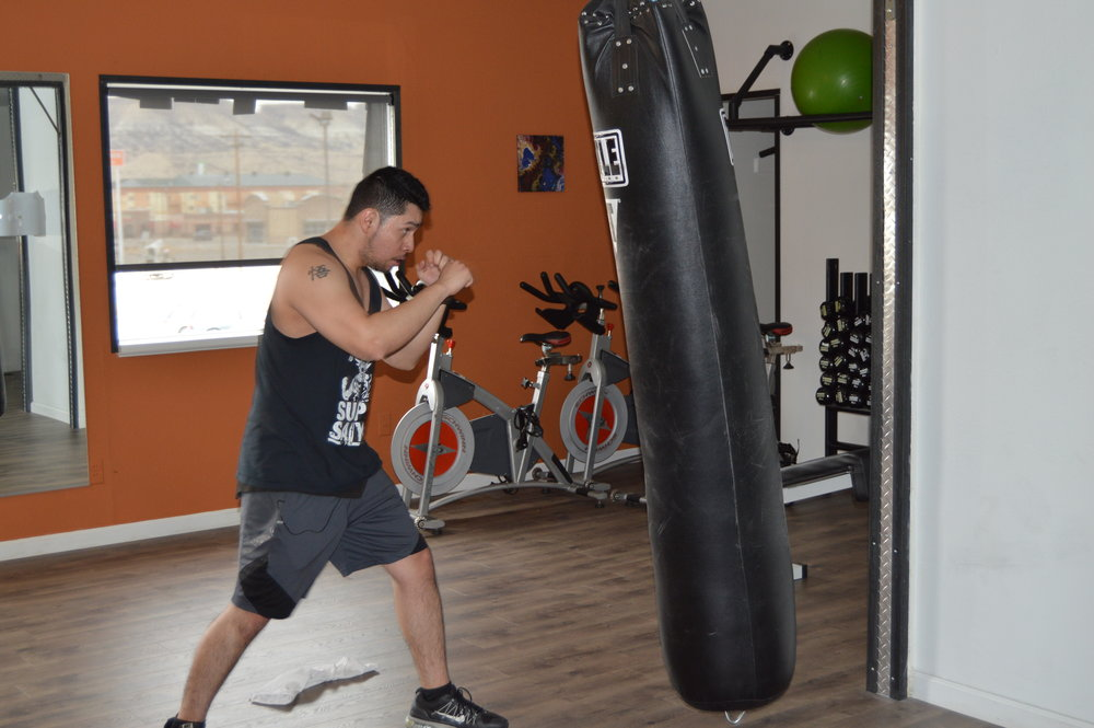- to the left our member Ronnie putting in some bag work! What a set of skills.