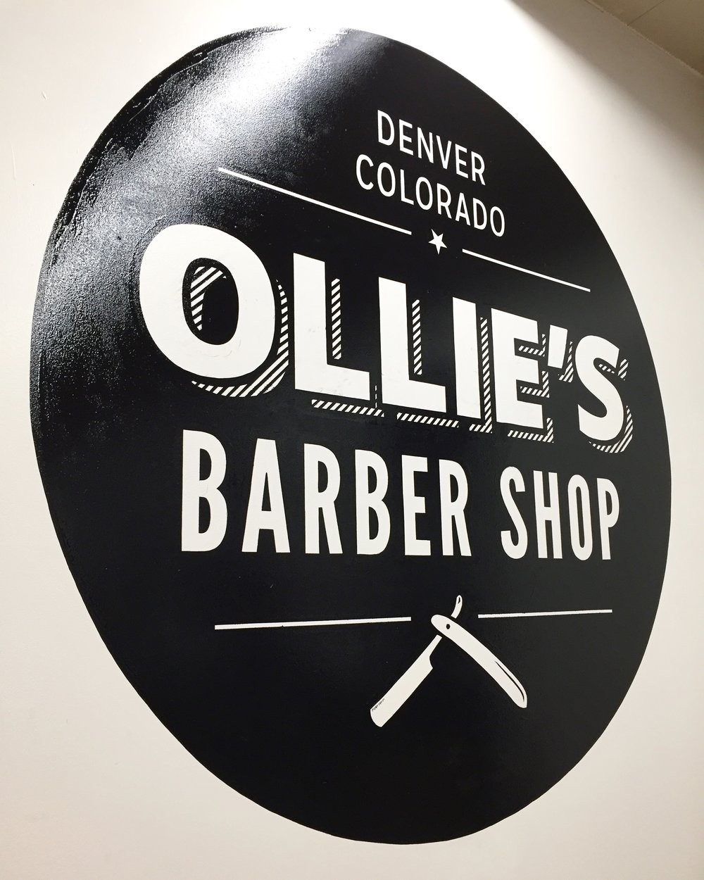 SIGNS IN SOCIAL MEDIA - Ollie's barber shop, located at 616 East Kentucky Ave in Denver, asked to have this previously designed logo added to a blank wall at the back of their shop. Not only does it add an artistic aspect to the wall but it aides in social media presence. Just about anyone taking a picture of the inside of this shop will have this sign shown in the background of their IG photo.
