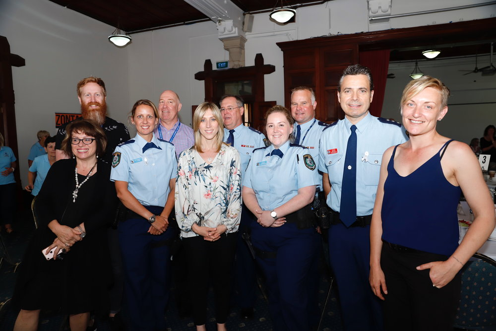Community Northern Beaches staff pictured with members of Manly Police and Guest Speaker, Jen Armstrong (far right)
