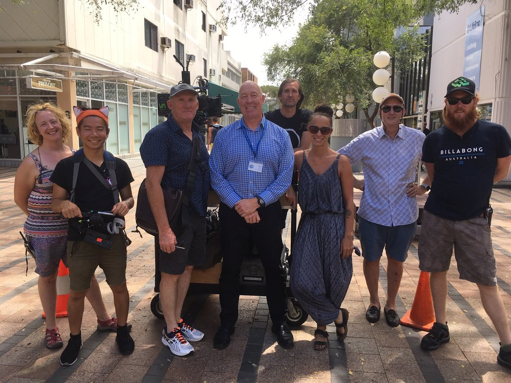 Pictured on location in Manly with Community Northern Beaches Executive Director John Kelly, is Director Ian Watson on John's right, and Location Manager Daniella on John's left, plus crew.