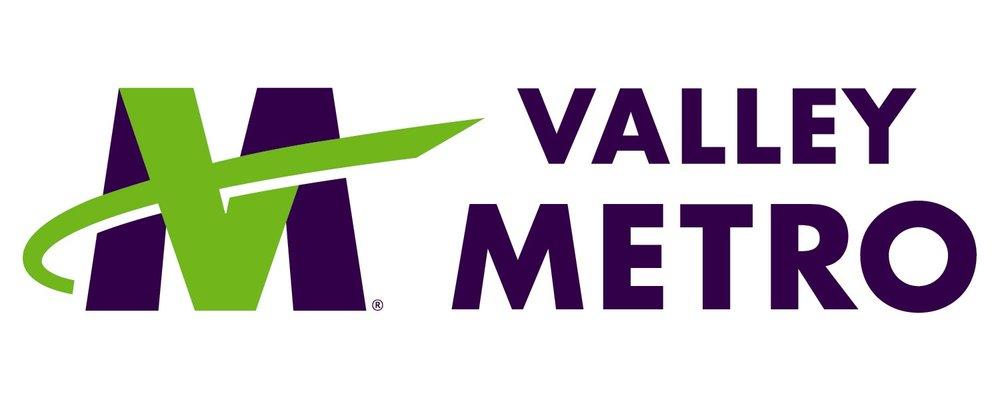 VM purplegreen with tagline.jpg