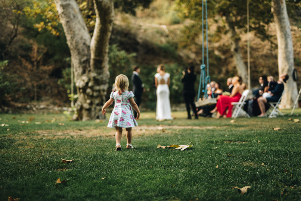 an energetic niece opted to watch the ceremony from several angles in the surrounding yard