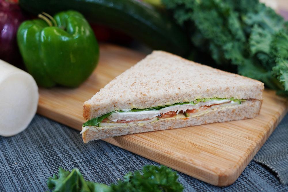 CHICKEN SANDWICH - 202.4 KCAL PER SERVINGHerbed Chicken Breast, Tomato, Cucumber, Lettuce Butter, Whole Wheat Bread$25/Single