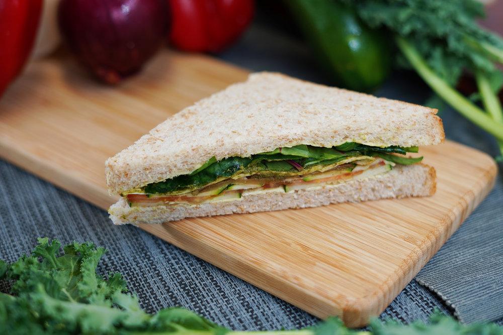 VEGGIE SANDWICH - 202 KCAL PER SERVINGEggplant, Tomato, Cucumber, Taro, Green Zucchini, Mixed Salad, Vegan Mayo, Whole Wheat Bread.$25/Single