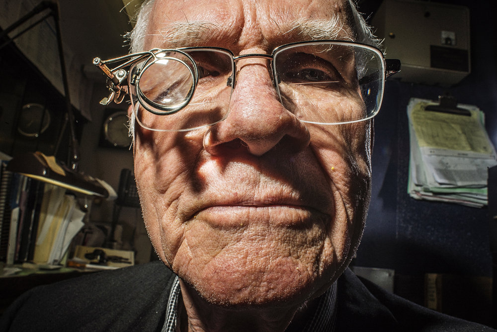 "Iowa City Jeweler, Willa Dickens, poses for a portrait in his office on Thursday, Jan. 19, 2017. He's been working In the business for 75 years and says, ""It's a challenge everyday with the beautiful and interesting things in the jewelry business. How can I be so lucky to call it work?"" (James Year/The Daily Iowan)"
