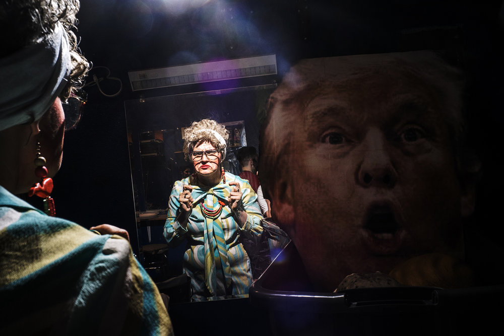 Varla stands beside an over-sized Trump mask in the Studio 13 dressing room shortly before emceeing a drag show on Thursday, May 31, 2018.