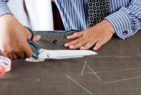 3. Cutting the Cloth:  Follows on from the pattern being chalked onto the fabric. Each part of the pattern laid in order to ensure that checks and stripes will neatly line up.