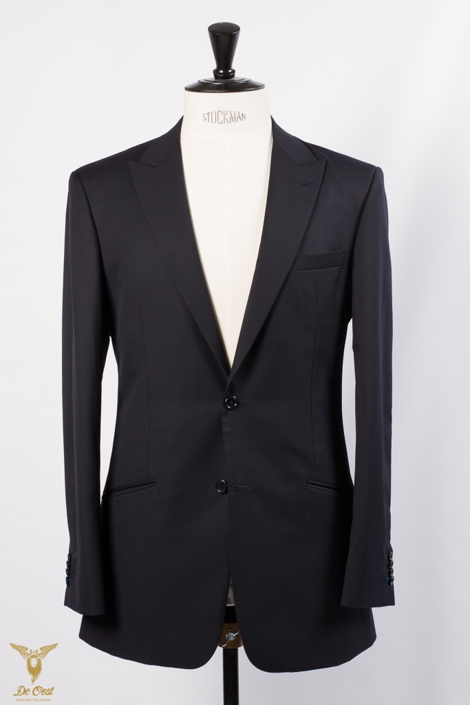 Midnight blue suit with 8 cm wide peaked lapels and slanted pockets