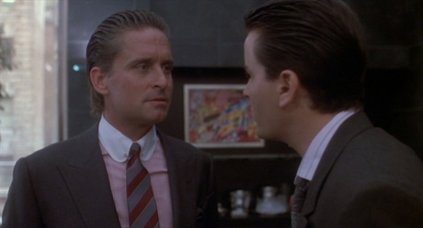 Michael Douglas wearing a rounded collar playing Gordon Gekko in Wall Street