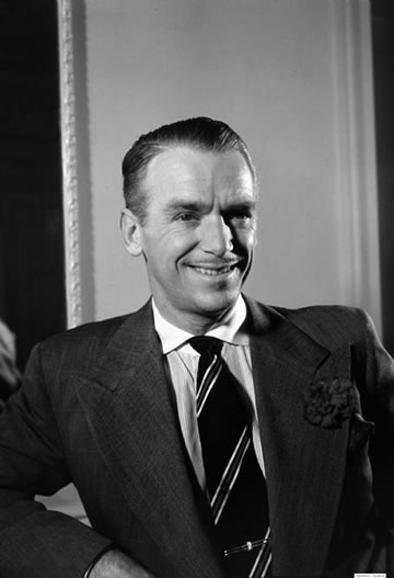 Douglas Fairbanks Jr. wide spread collar shirt.jpg