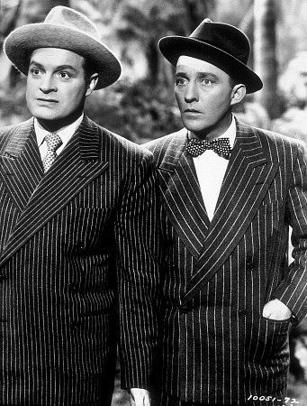Bob Hope and Bing Crosby wearing doublebreasted striped suits with wide lapels.