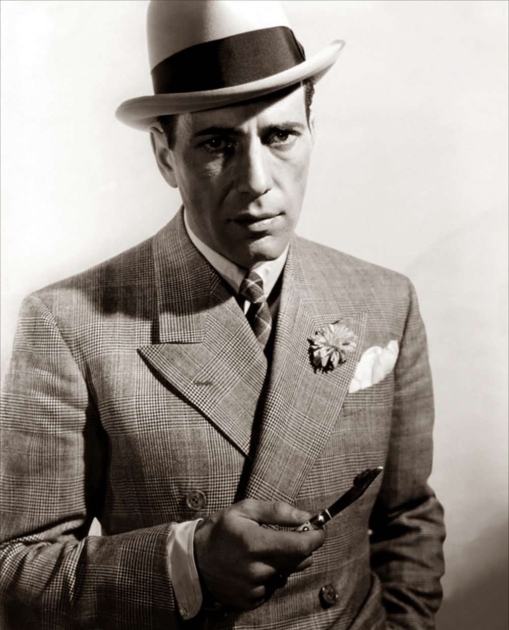 Humphrey Bogart in a double breasted Glen Plaid suit.