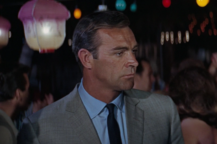Sean Connery as James Bond wearing a classic light blue shirt