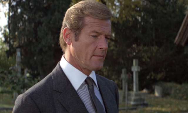 Roger Moore wearing a Bengal striped shirt with contrasting collar