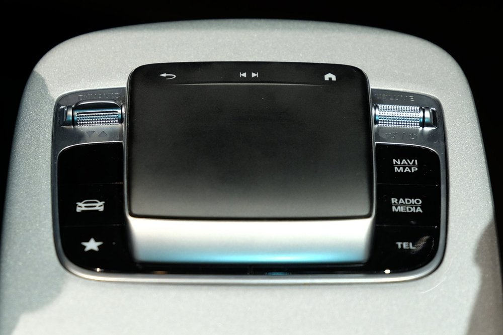 The new touchpad design eliminates the rotary knob below and looks a lot like Lexus' much maligned input device