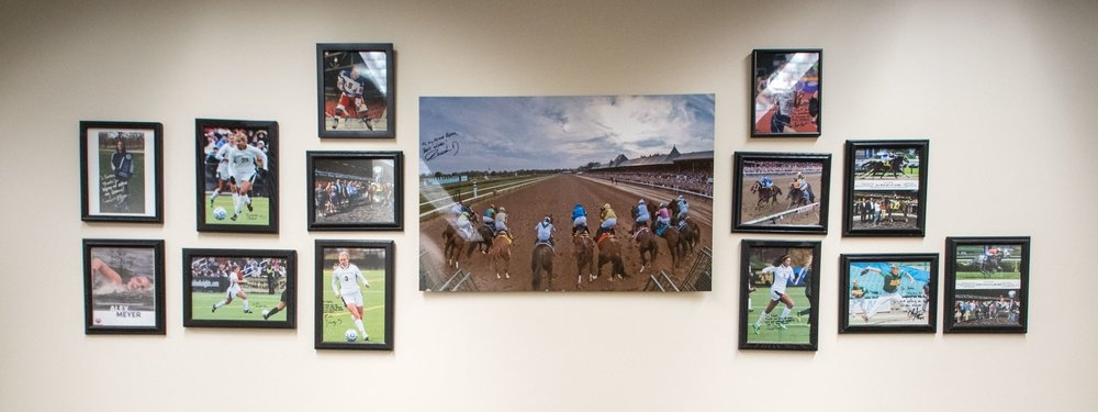 Autographed photos of professional athletes chiropractic patients.
