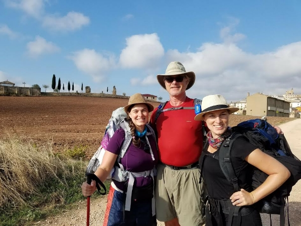 Tim Leach, pictured here with his two daughters walking the Camino in Spain.