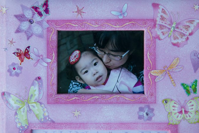 """Yuna and her mother in a family photo. Born in Texas during a rare snowfall, her name, Yuna, means """"snow girl"""" in a Korean dialect."""