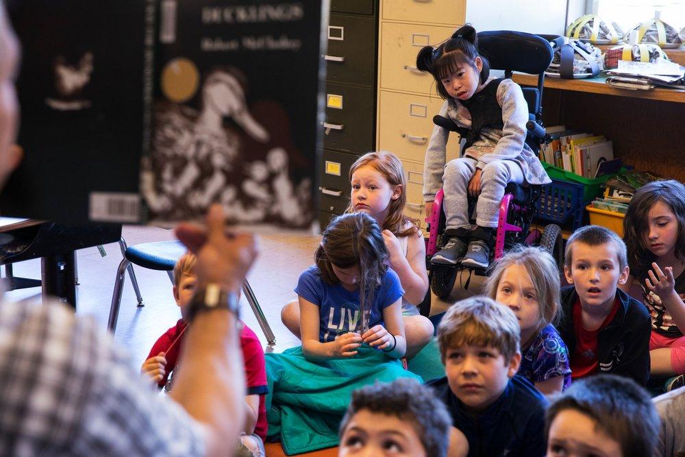 Listening to a teacher read.