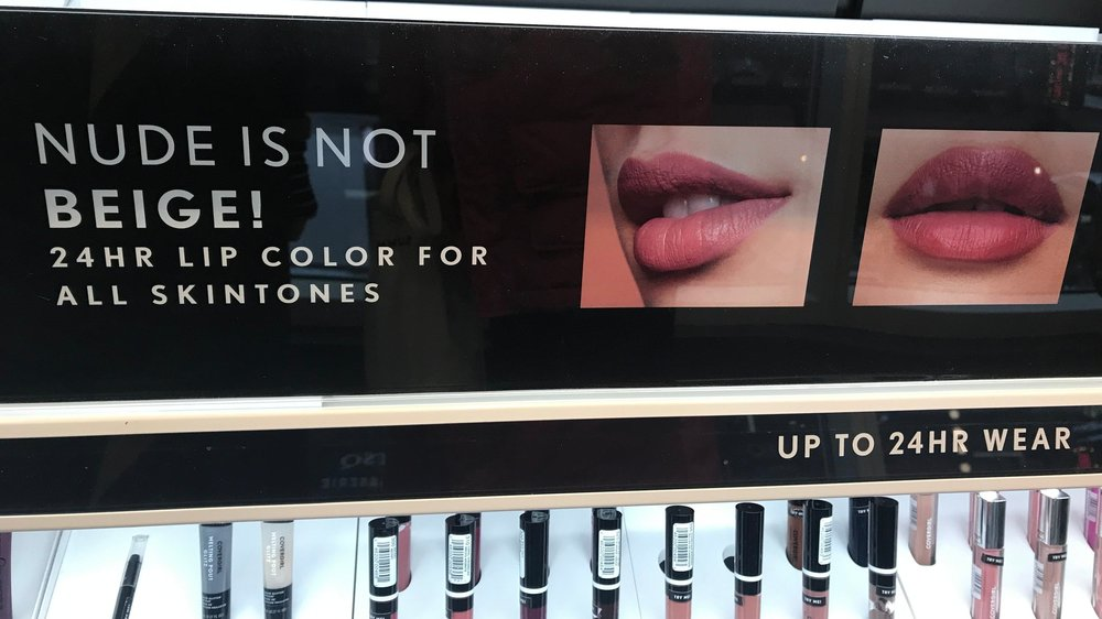 """Nude is not beige!"" sign at the COVERGIRL Store."