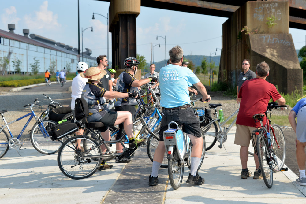 Attendees learn about Hazelwood Green during the Green Building Alliance bicycle tour, July 2017.  Photography by Bradd Celidonia, GBA