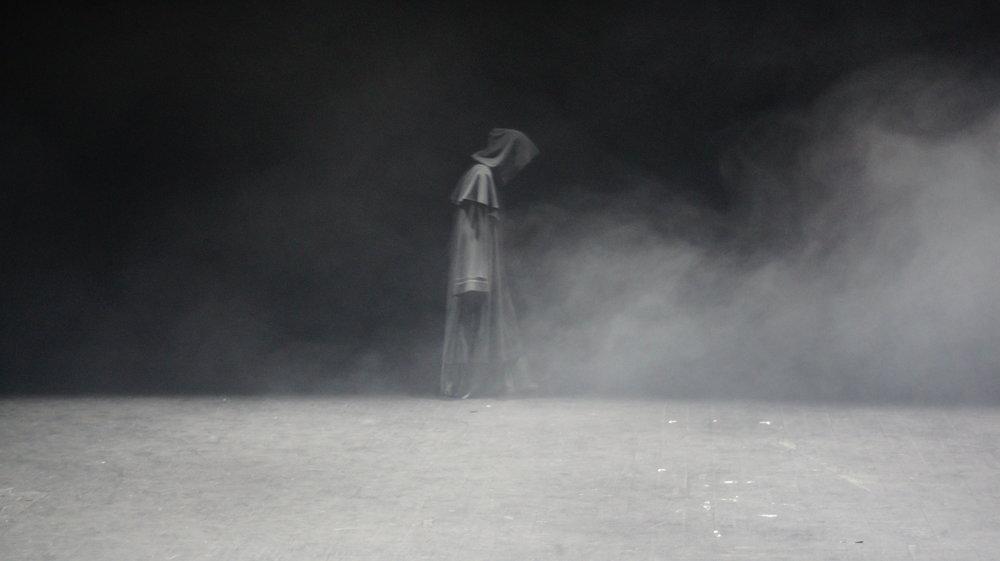 Figure Crosses Stage.JPG