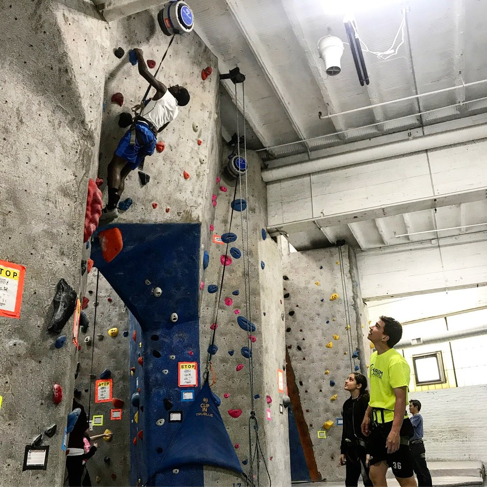 Peter (Program Director) and Gabby, watching Kenny reach the top