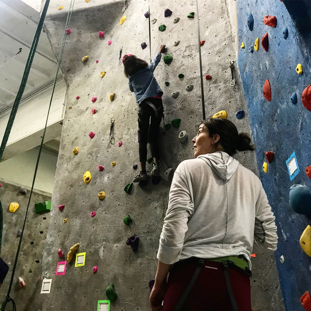 Annie (Elevate Youth Outdoor Activities Coordinator) looking impressed by a climber