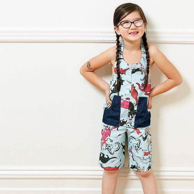 Pledging $85 will get you the Annie E overall. Annie E is a puddle jumper, a shore wader, and a tree climber. Bermuda length overall with halter straps and beautiful contrast cotton lining on the bib top.  Includes Temporary Tattoo and Button Set.  Prints: Dino or Pussy