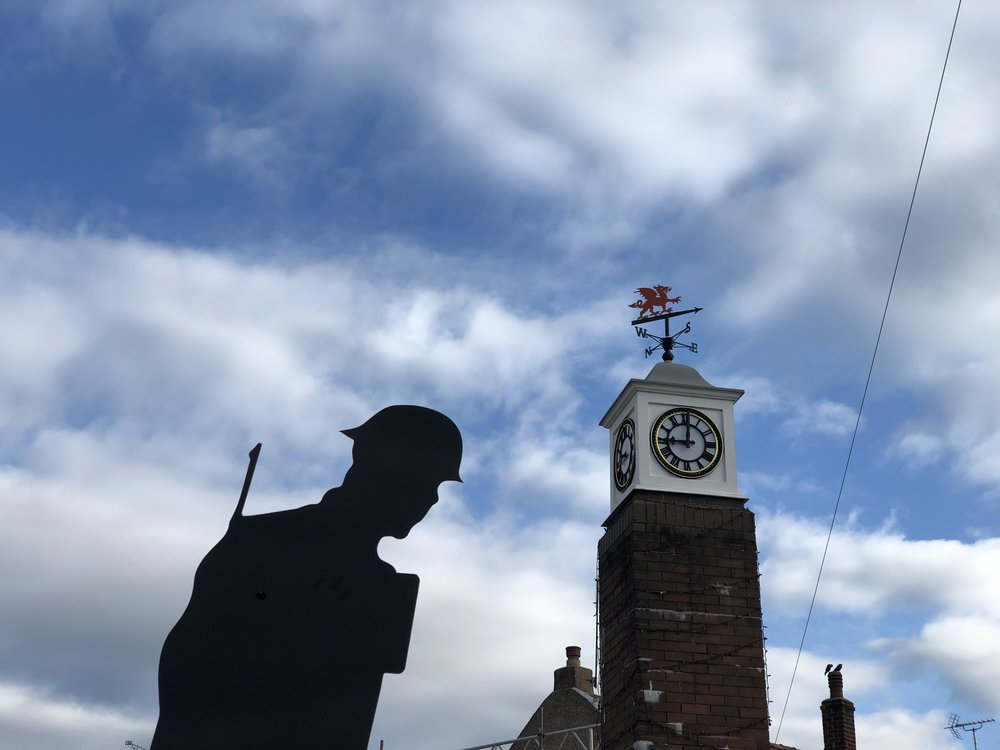 Tommy alongside the Pen-y-ffordd Millennium Clock.