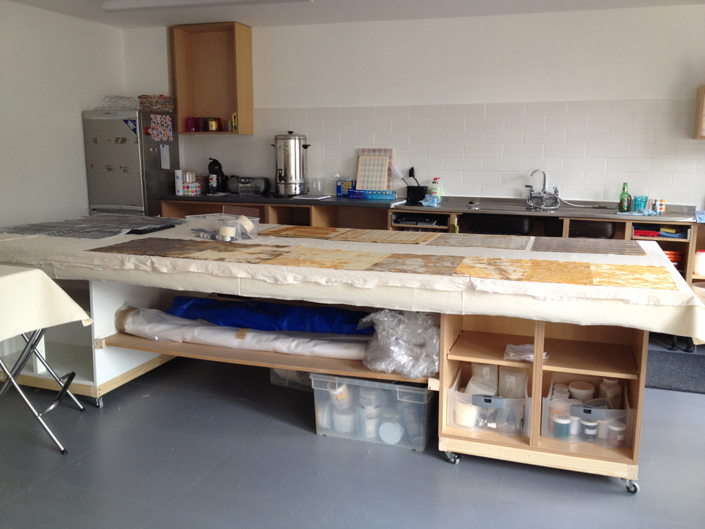 Print bench (140cm x 350cm) is built on top of kitchen units with long wide shelf in between.
