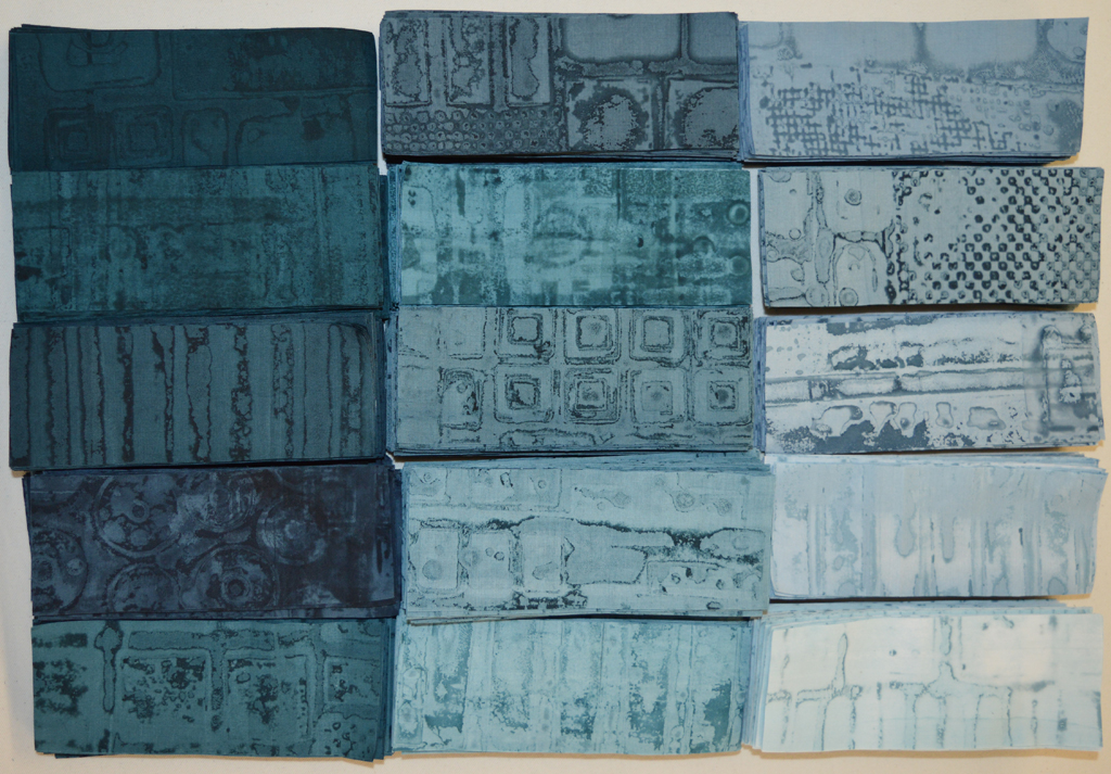 Breakdown printed fabrics cut into hundreds of bricks ready to build new art