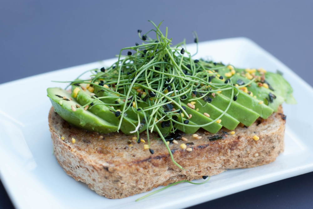 AVOCADO TOAST - sesame-miso butter, micro onion sprouts, whole grain bread