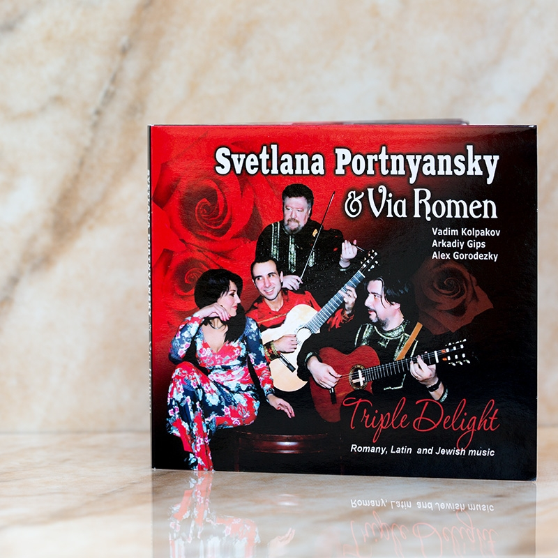 © 2011 Los Angeles, California, USA All rights reserved.   SVETLANA PORTNYANSKY & VIA ROMEN TRIPLE DELIGHT Romany, Latin and Jewish Music   01. Davai prisyadem i pogovorim (Z.Kharabadze, V. Sokolov)  02. Balada para mi muerte (A.Pizzola, H.Ferrer)  03. Gitana Judia  (A.Gorodetsky, A.Gips)  04. Senora Melancolia (W.Morales)  05. Historia de un amor (C.Almaran)  06. My shtettle Beltz (A.Olshanetsky)  07. Al Kapav Yavi (Y.Rozenbloom)  08. El Dia Que Mi Quieras (C.Gardel)  09. Ah, yamshik, goni-ka k yaru...  (A.Yuriev, B.Andrievsky)  10. Sasha Kolpakov's Fantasy (A.Kolpakov)