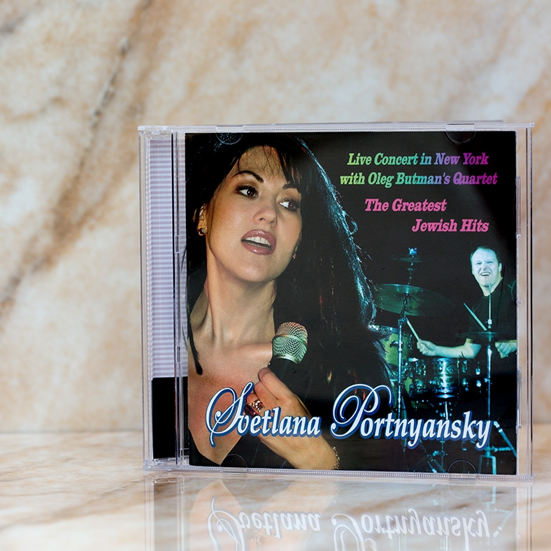 "© 2005, Los Angeles, California, USA All rights reserved. Svetlana Portnyansky ""Live Concert in New York with Oleg Butman's Quartet The Greatest Jewish Hits"" 01.Yerushalaim (N.Yenatan, M.Amarilio) 02.Lekhaim (Yiddish Folk) 03.Ih Bin a Tzigainer (Yiddish Folk) 04.Abi Gezund (A.Ellstein) 05.Babyi Yar (I.Pushkar, A.Korotko) 06.Na'aritzeha (P.Yassinovsky Hebrew traditional) 07.Lomir Zih Iberbeitn (Yiddish Folk) 08.""Shalom, Dolly"" (J.Herman, Yiddish Lyrics, M.Nemirovsky) 09.Zog Es Mir Nokh Amol (A.Ellstein) 10.Ba Mir Bistu Shein (S.Secunda) 11.My People (A.Zlotnik, Y.Ribchinsky) 12.Ose Shalom (S.Glazer) 13.Hatikva"