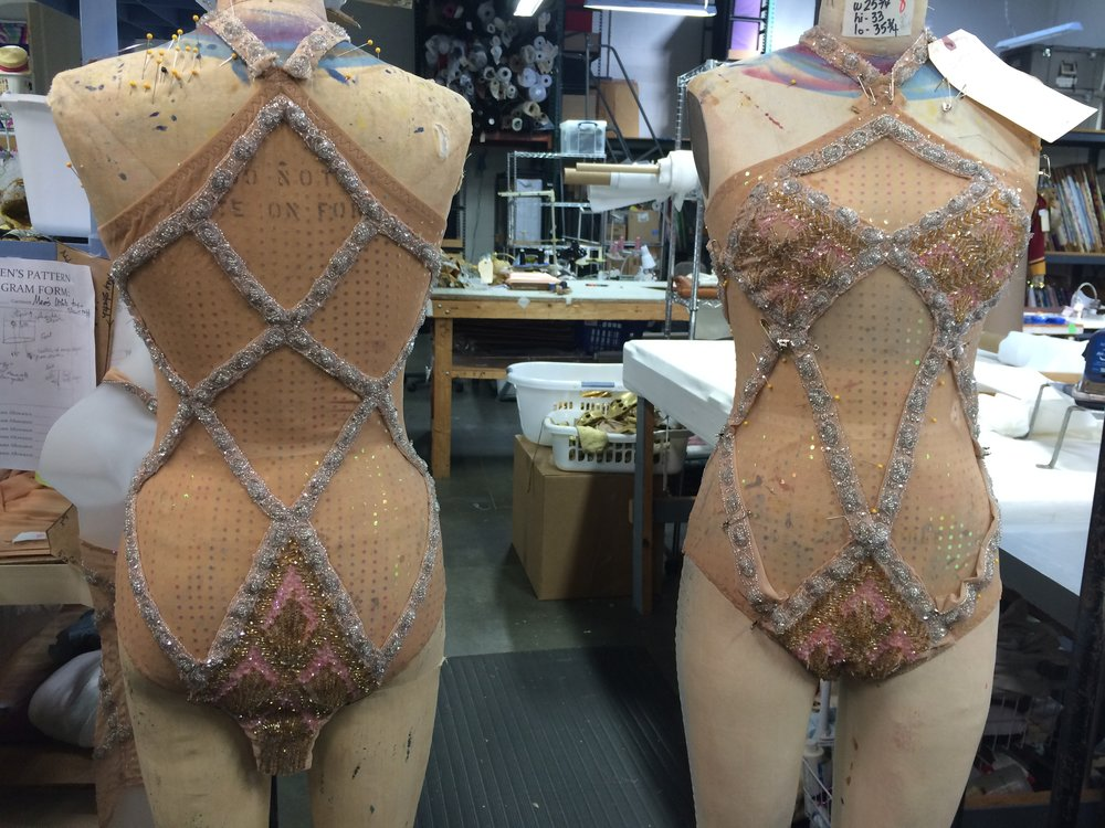 Reattaching and repairing beaded appliqué onto leotards. Pictured in progress.