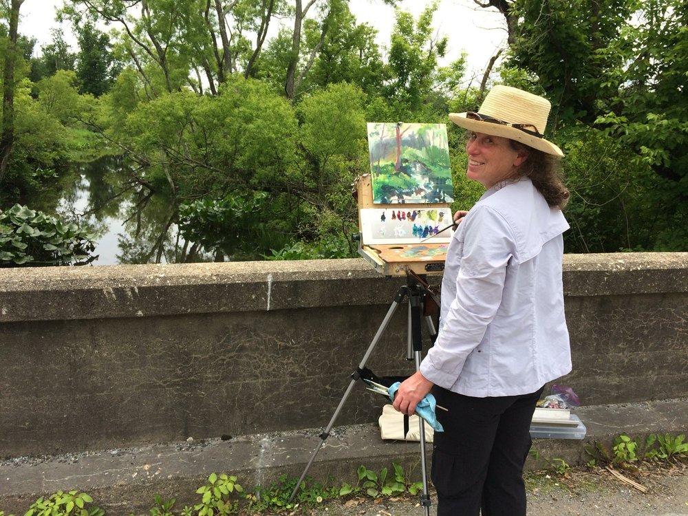 Deena Ball painting on bridge.JPG