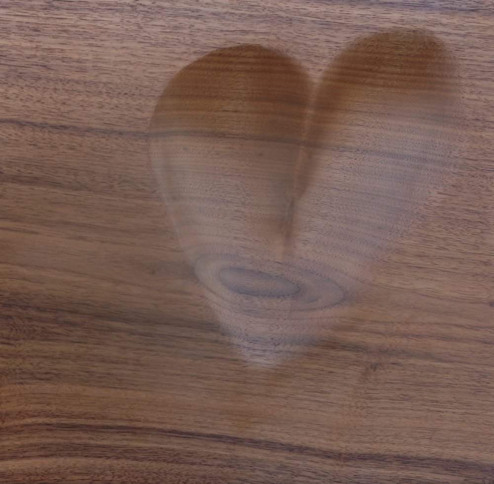 Black walnut board with carved heart for serving snacks and dips