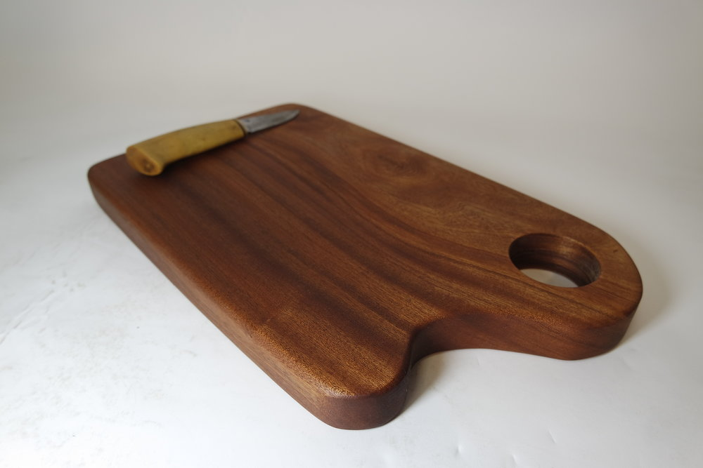 Sapele chopping board with carved handle