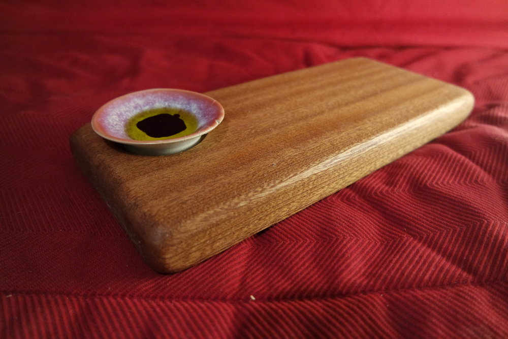 Small serving board with hand made oil bowl