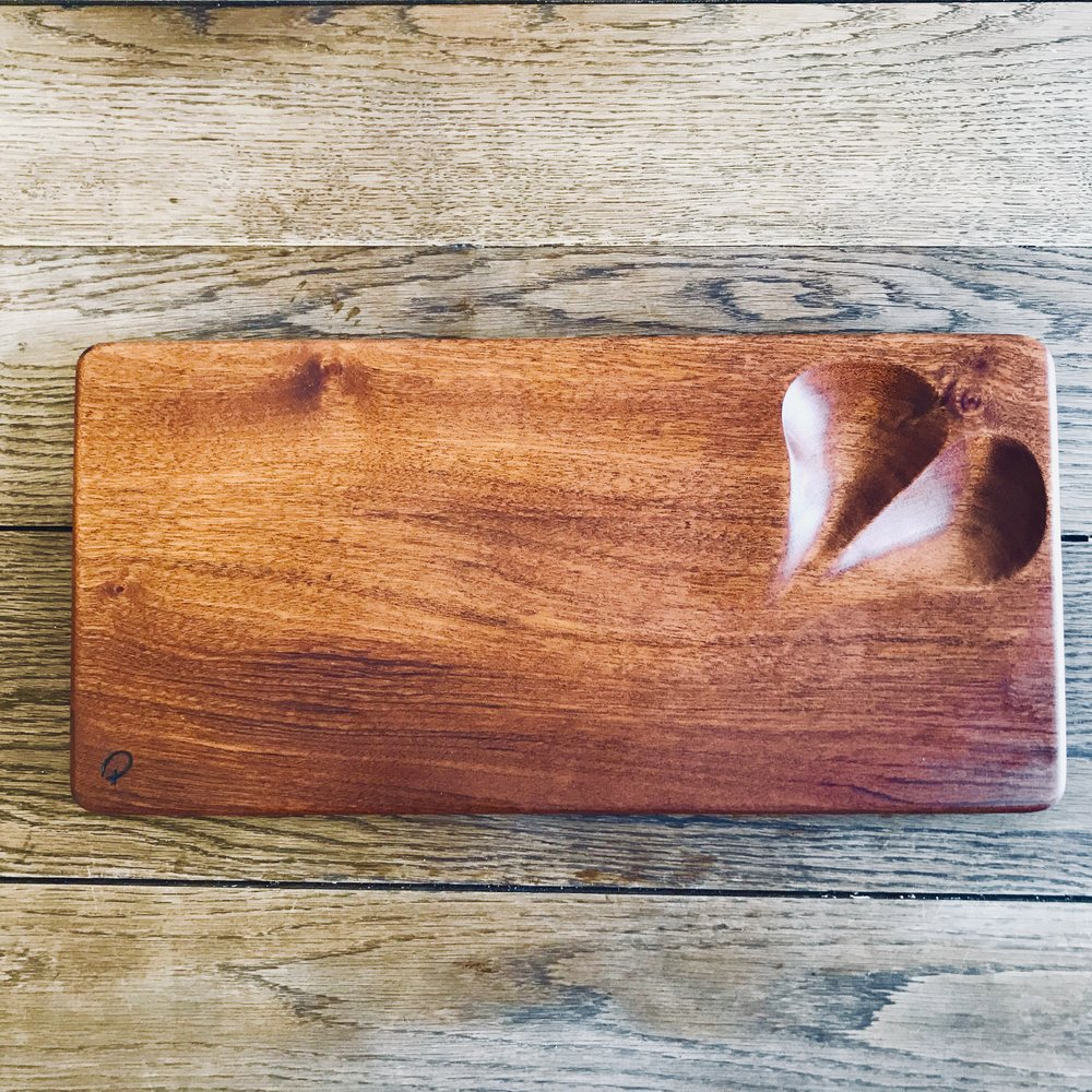 - The Sapele Serving platter with heart dish