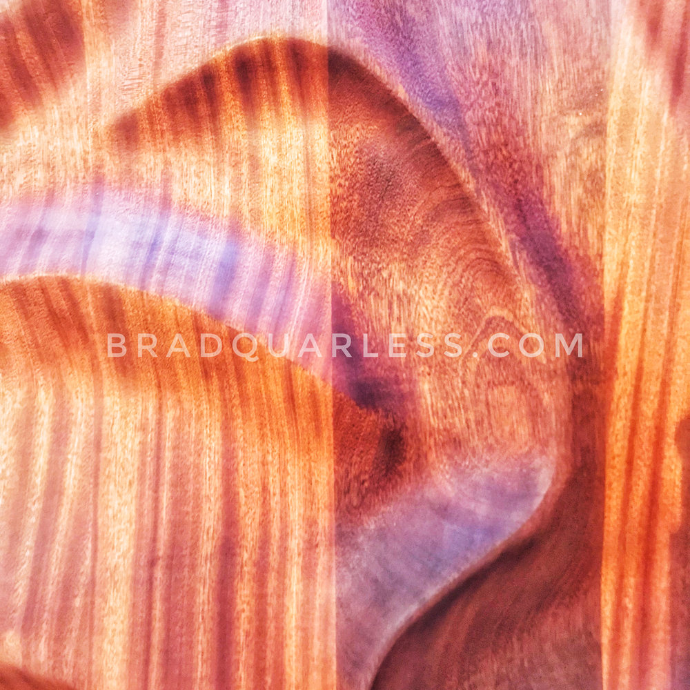 Detail shot of the curved sand lines in Sapele wood.