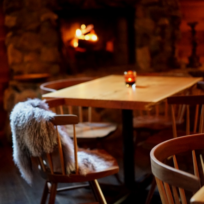 cozy tables by the fire