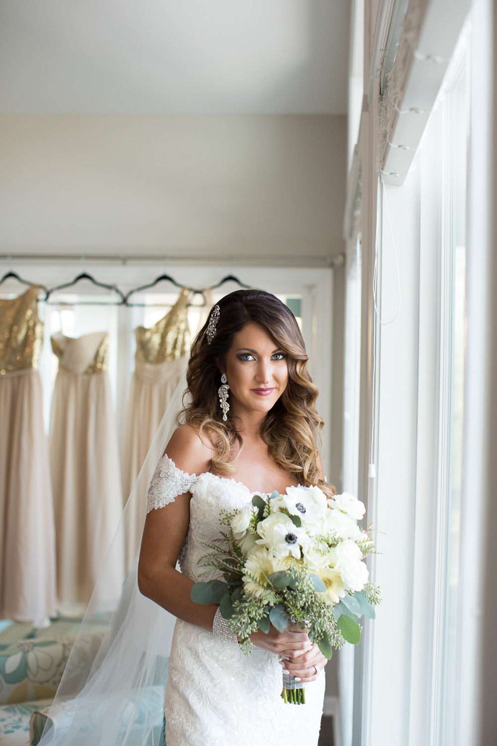 Her lovely bridal hair and makeup look was created by Hilari Forrester.